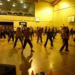 Photograph of Zumba participants with floor shadows