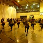 Photograph of Zumba participants stepping back