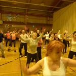 Photograph of Zumba participants with lady in forground