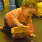 Photograph of child playing with play equiptment