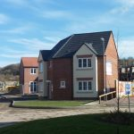 Photograph of more new houses completed and this time a corner plot