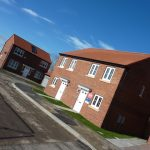 Photograph of more new houses completed including two semis