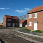 Photograph of more new houses completed this time an end plot