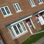 Photograph of more new houses completed set on an angle