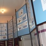 Photographs of display boards and exhibition materials from ground level