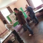 Photographs of people looking at proposals and display boards and exhibition materials