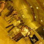 Photograph of people gathing at community event in Leisure centre