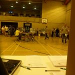 Photograph of leisure Centre hall with people milling about