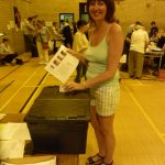 Photograph of beautiful woman voting