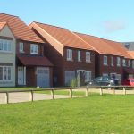 Photograph of more new houses completed including the estate green