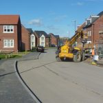 Photograph of more new houses completed with heavy plant