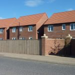 Photograph of more new houses completed taken from the haul road
