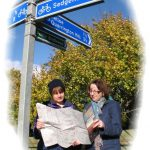 Photograph of walkers reading map