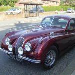 Photograph of old Jaguar in dark red