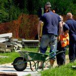 v workmen with wheel barrow