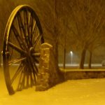 photograph of pitwheel in the snow in sepia colour