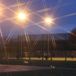 Photograph of playing fields at night with star filter