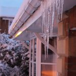 Photograph of icicles on house