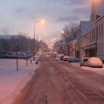 Photograph of of snowy front street