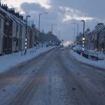 Photograph of front street in the snow looking south