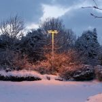 Photograph of snowy lamplight scene