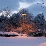 Photograph of snowy lamplight scene