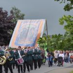 Photograph of band marching with banner