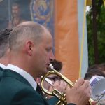 Photograph of talented man playing cornet