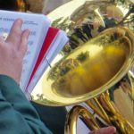 Photograph of music and instruments in close up on village green
