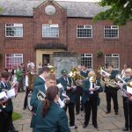 Photograph of band outside village hall plying gracefully