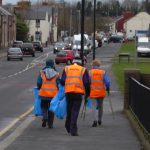 Photograph of volunteer litter pickers travelling to meeting place