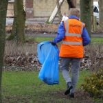 Photograph of volunteer litter picker working really hard whn its the County Council's responsibility