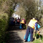 Photograph of volunteer litter pickers in action on Parsons walk or Dog Poo alley