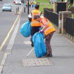 Photograph of volunteer litter pickers on main street
