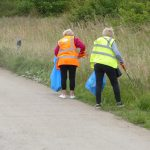 Photograph of volunteer litter pickers on the haul road