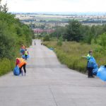 Photograph of volunteer litter pickers at work on both sides of road