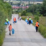 Photograph of volunteer litter pickers collecting litter, there's plenty of it