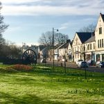 Photograph of village green in spring with front street in back