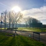 Photograph of a sun filled village green in spring