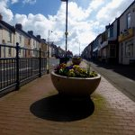 Photograph of planter in front street with shadow