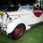 Photograph of classic car two seater in white