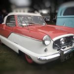 Photograph of red and white two seateramerican car