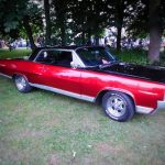 Photograph of red classic american car