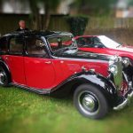 Photograph of classic car in red and black