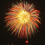 Photograph of firework against dark sky