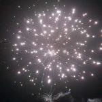 fireworks going off shining lights