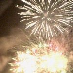 fireworks going off absolutely filling the dark night with light