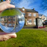 artistic Village Hall through crystal ball upside down tree