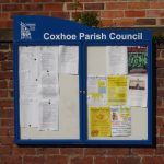 Coxhoe notice board on church wall