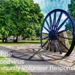 Photograph od Pitwheel with words superimposed written in white. the words say Coxhoe Coronavirus Community Volunteer Reaponse